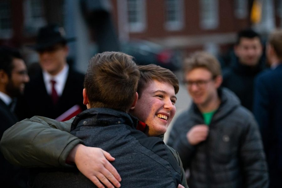Kazz White (right), a member of Phi Mu Alpha, hugs his  fiancé, Ben Wingerter (left) after the  members of Phi Mu Alpha finish their serenade on Saturday, Feb. 15.