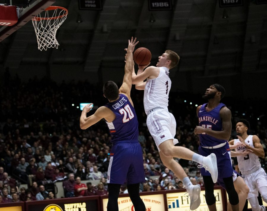 Southern Illinois University Saluki number one forward, Marcus Domask, jumps for a basket basket during the basketball game against the Evansville Purple Aces in the SIU Banterra Center. The game ended 53 to 70 with SIU taking the win on Thursday night, February 20, 2020.