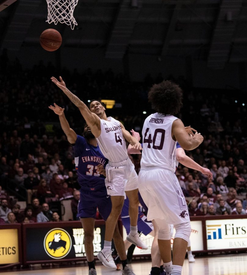 Southern Illinois University Saluki's go for a basket, scoring against the Evansville Purple Aces during the SIU vs UE basketball game in the SIU Banterra Center. The game ended 53 to 70 with SIU taking the win on Thursday night, February 20, 2020.