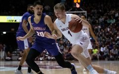 Southern Illinois University Saluki number one forward, Marcus Domask, protects the ball during the basketball game against the Evansville Purple Aces in the SIU Banterra Center. The game ended 53 to 70 with SIU taking the win on Thursday night, February 20, 2020.