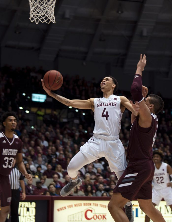 Southern Illinois University Saluki number four, Eric McGill, Guard, goes for a basket and scoring against Missouri State Bears during the Saturday night game at the SIU Banterra Center ending the game Mo State 66 to SIU 68 on February 8, 2020.