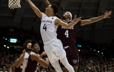 Southern Illinois University Saluki number four, Eric McGill, Guard, went for a basket and scored against Missouri State Bears during the Saturday night game at the SIU Banterra Center ending the game 66 to 68 with SIU Salukis taking the win on Feb. 8, 2020.