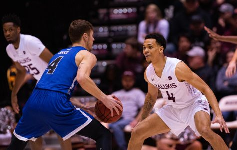 Salukis guard Eric McGill takes on a Sycamore guard during SIU's Senior Night. SIU would go on to loss to Indiana State 77-68 on Wednesday, Feb. 26, 2020 at the Banterra Center.  Jared Treece @bisalo