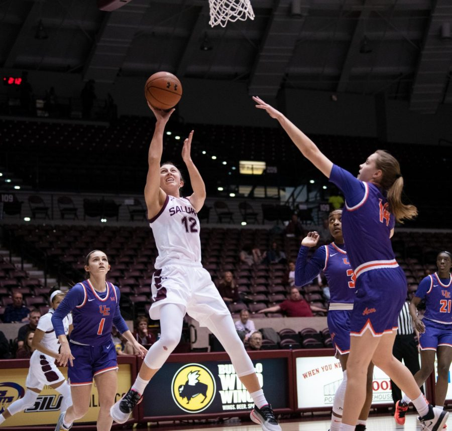 Southern Illinois Saluki number 12 guard, Makenzie Silvey, goes for a basket during the Sunday afternoon game against the Evansville Purple Aces. The game ended 99 to 60 with SIU taking the win on February 23, 2020 at the SIU Banterra Center.