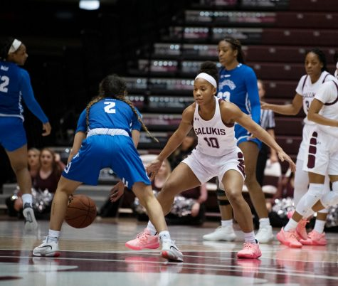 Southern Illinois Saluki number 10 guard, Brittney Patrick, fights to get the ball from Indiana State Sycamores during the Friday night woman's basketball game at the SIU Banterra Center. The game ended with SIU at 60 and ISU at 42 on February 21, 2020.