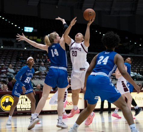 Southern Illinois Saluki number 20 forward, Gabby Walker, goes for a basket against Indiana State Sycamores during the Friday night woman's basketball game at the SIU Banterra Center. The game ended with SIU at 60 and ISU at 42 on February 21, 2020.