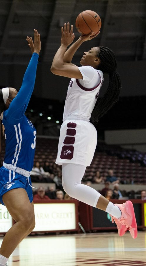 Southern Illinois Saluki number 34 forward, Nicole Martin, jumps for a basket to score against Indiana State Sycamores during the Friday night woman's basketball game at the SIU Banterra Center. The game ended with SIU at 60 and ISU at 42 on February 21, 2020.