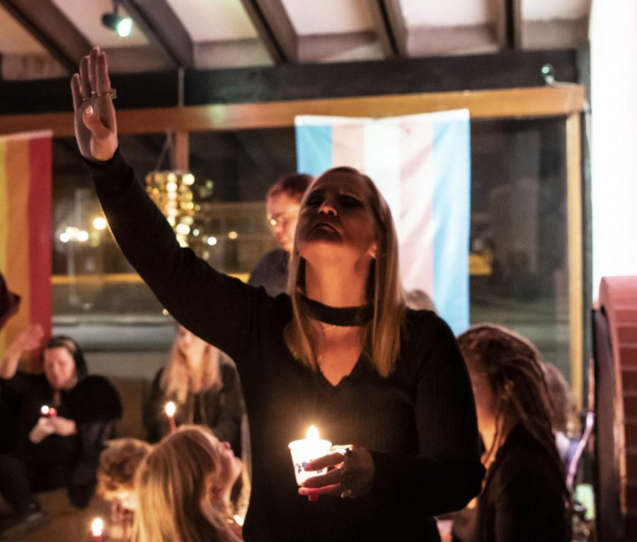 "Monica Thomas raises her hand in prayer at the Imbolc ceremony on Saturday, Feb. 1 at the Gaia House in Carbondale. Thomas said when her faith came into her life, it changed her. ""It changed me as a person for the better,"