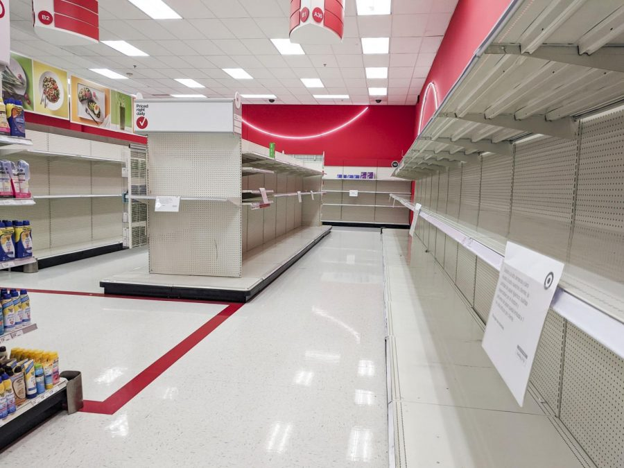 Toilet paper shelves stand empty at the Target store in Overland Park, Kansas on Monday, March 23. The store placed limits of one item per person on high-demand items including toilet paper, paper towels, tissues, hand sanitizer and wipes.