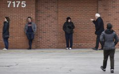 Customers at Binny's Beverage Depot practice social distancing while waiting to enter the store on March 20 in Lincolnwood, Illinois. The CDC recommends staying at least 6 feet away from other people in public places.