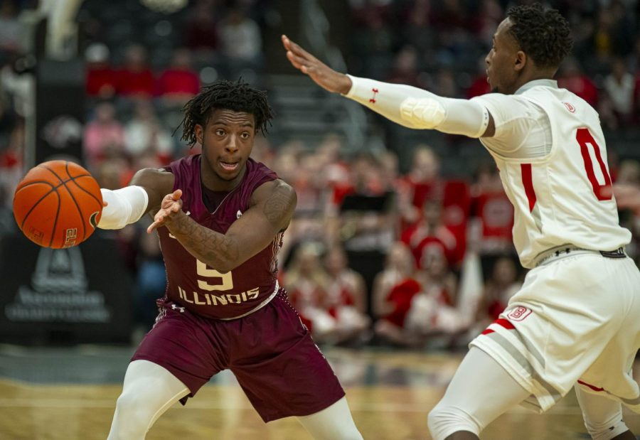 Freashmen Lance Jones moves the basketball around the court during SIU's loss to Bradley during Arch Madness on Friday, Mar. 6, 2020 at the Enterprise Center in St. Louis.