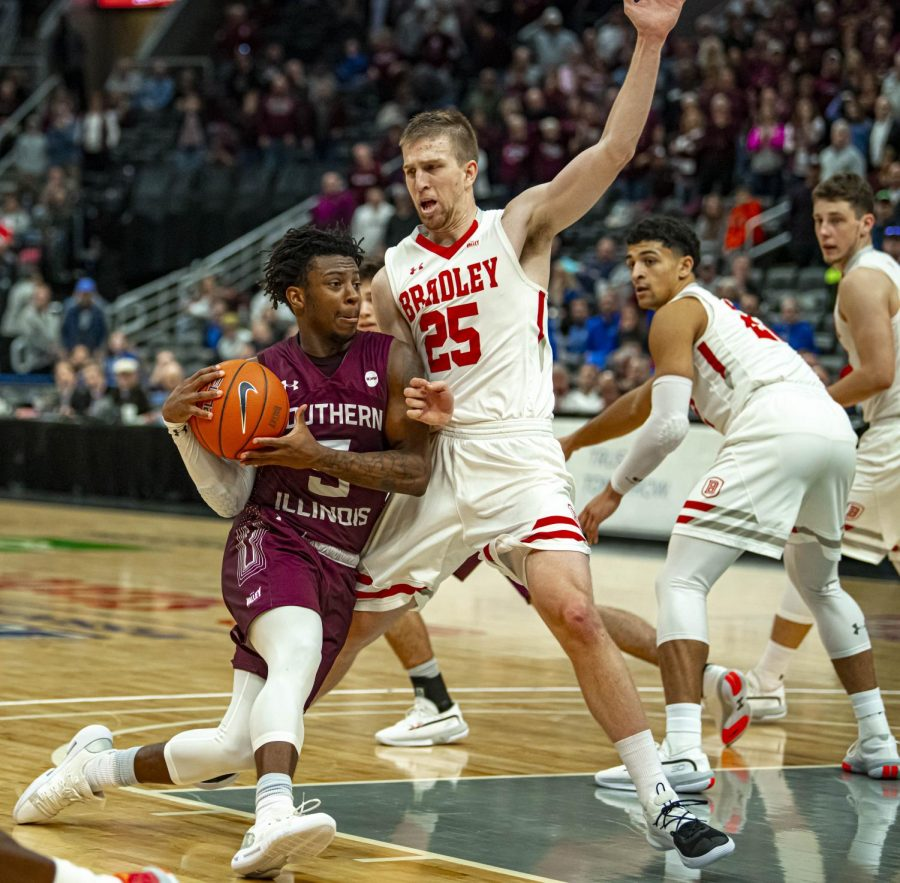 Salukis guard Lance Jones drives hard downtown pass a Braves' defender during the 59-64 loss to Bradley during Arch Madness on Friday, Mar. 6, 2020 at the Enterprise Center in St. Louis.