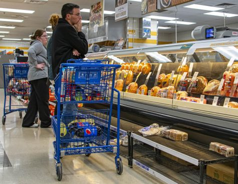 People wait in lines to buy food and supplies as the hysteria surrounding COVID-19 spreads on Sunday, Mar. 15, 2020 at Meijer in Springfield, IL.