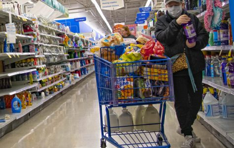 A customer takes precautions while out in public areas on Sunday, Mar. 15, 2020 at Meijer in Springfield, IL