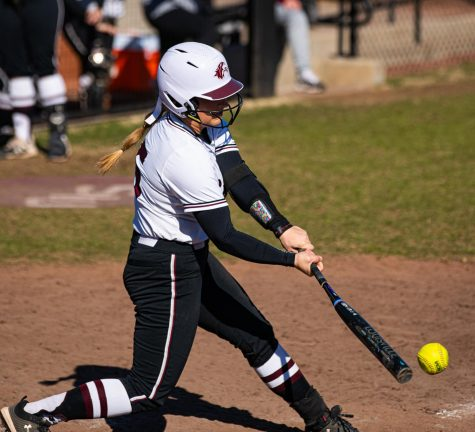 Salukis freashmen Tori Schullian gives a hard swing  to earn a hit during SIU's 5-0 shutout win vs. North Kentucky University on Saturday, Feb. 29, 2020 at Charlotte West Stadium at SIU.