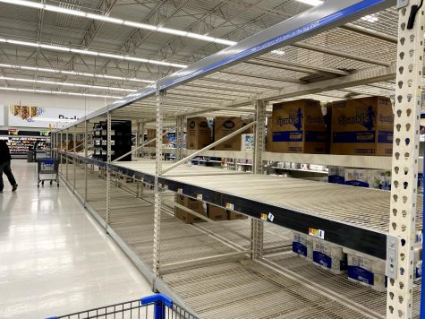 The toilet paper aisle at the Carbondale Walmart sits empty amid coronavirus shortages on Sunday, March 15.