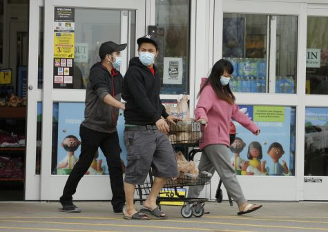 Shoppers leave Kroger supermarket, Carbondale, IL, Saturday, April 4, 2020.  Some shoppers opted to wear medical masks to help protect against the Covid-19 pandemic.