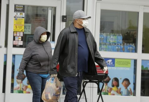 Shoppers leave Kroger supermarket, Carbondale, IL, Saturday, April 4, 2020.  Some shoppers opted to wear medical masks to help protect against the Covid-19 pandemic.     (Angel Chevrestt, 646.314.3206)