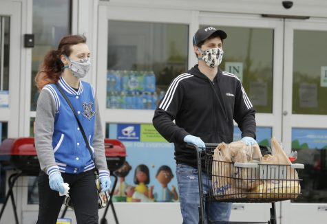 Shoppers leave Kroger supermarket, Carbondale, IL, Saturday, April 4, 2020.  Some shoppers opted to wear homemade medical masks, bandanas, or some other improvised facial covering to help protect against the Covid-19 pandemic.     (Angel Chevrestt, 646.314.3206)