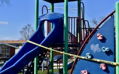 The playground equipment at Ni-Ridge Park in Park Ridge, Illinois is wrapped in caution tape to discourage children from playing. Illinois Executive Order 2020-10 closed all public playgrounds in the state to prevent the spread of COVID-19.