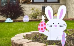 "Easter decorations are set up on a front yard on Monroe Street in Niles, Illinois on Sunday, April 12. The Facebook group ""Emerson Place Neighbors"" requested families in the neighborhood to put up an Easter display so area children can have an egg hunt that follows social distancing guidelines."
