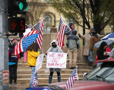 Orphans of the American Dream hosted the Reopen Illinois Rally in downtown Springfield where protesters displayed flags and signs supporting their disapproval towards the shelter-in-place order on April 25, 2020 at the Illinois State Capital Building.