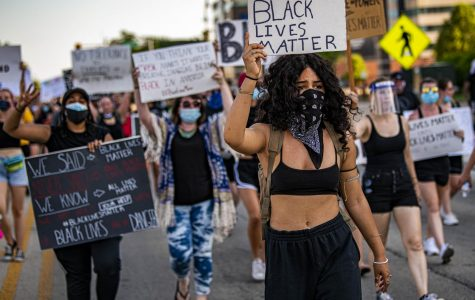 Protesters take to the streets of downtown Springfield with several signs and chants in support of Black Lives Matter in the wake of the death of George Floyd on Saturday, Jun. 6, 2020 in downtown Springfield, Ill.