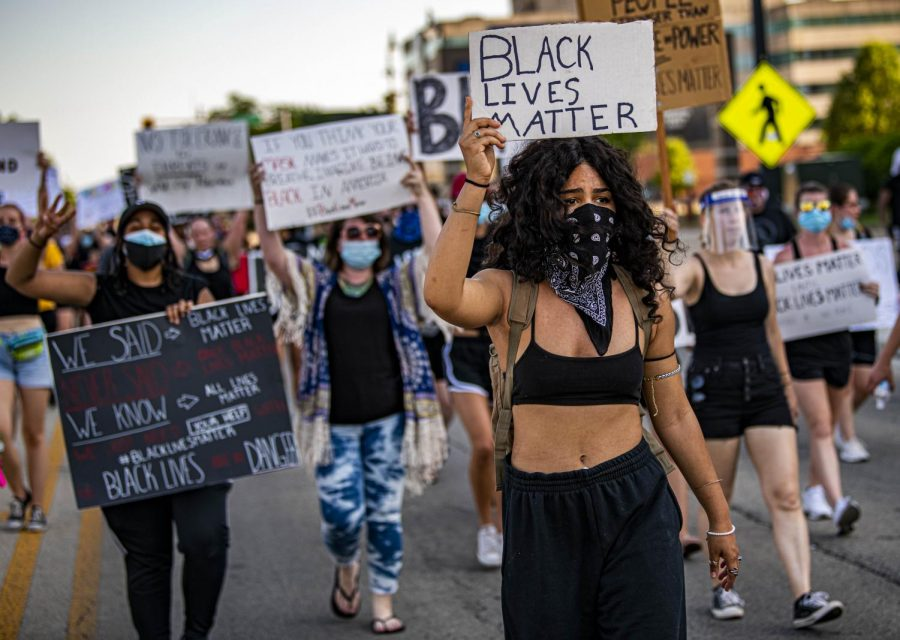 Protesters march the streets of downtown Springfield, Ill. with signs and chant in support of the Black Lives Matter movement in the wake of the death of George Floyd Saturday, Jun. 6, 2020.