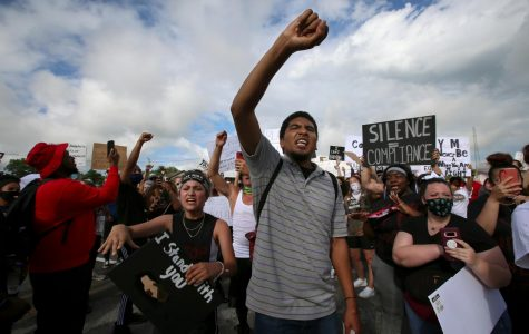 Janet Gomez, 18, left, of Cobden, IL and Aveon Winfield, 21, right, of Grand Chain, IL participate in a Black Lives Matter demonstration in the town of Anna, Illinois, Thursday, June 4, 2020.