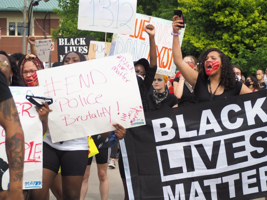 Protesters chant and dance while waiting to cross the train tracks during a Black Lives Matter protest, June 5, 2020, Carbondale, ILL.