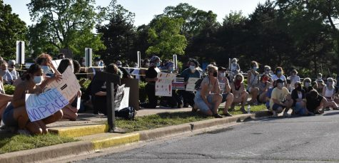 Attendees take a knee, a sign of peaceful protest popularized by former 49ers quarterback, Colin Kaepernick, Tuesday June 2. 2020 in Park Ridge Ill.
