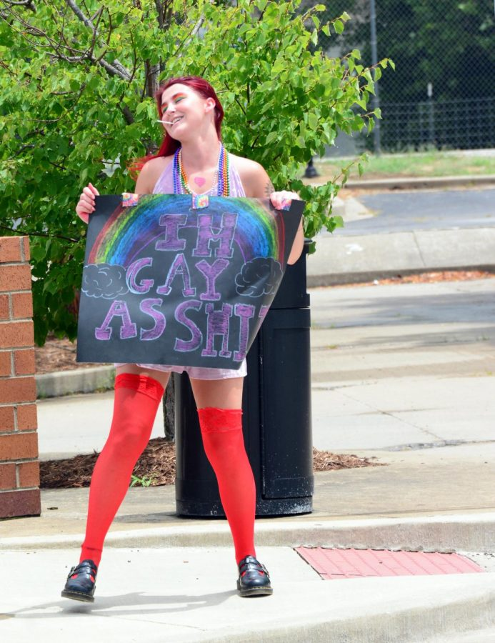 Kiersten Owens, dances with her sign during Pride, June 28, 2020, Carbondale, ILL.
