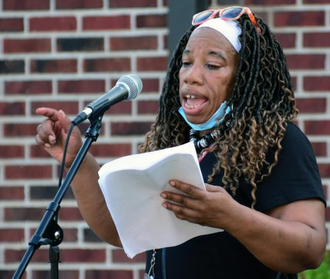 "Nancy Maxwell reads a poem at the ""Blackout Tuesday"" event July 7. 2020, in Carbondale, ILL. The poem that Maxwell read is about being tired, she said, ""I am tired of using things to make me lighter and whiter."""