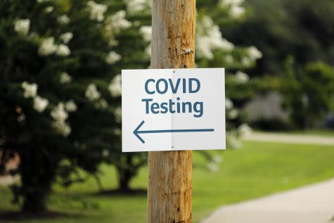 """Covid Testing"" signage at a Covid-19 drive-thru test site run by the SIH Memorial Hospital of Carbondale, located at the former Regions Bank building, Rt 13 and Poplar Street (500 W. Main Street), Carbondale, IL, Wednesday, July 29 ,2020.  Angel Chevrestt // @sobrofotos"