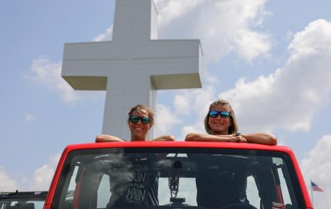 """Amanda Schneid and Chaz Stortz of Burfordville, Mo. pose after traveling about an hour and a half to the Blessing of the Jeeps event in Alto Pass, Ill. """"I think everyone needs blessed"""" Stortz said on Aug. 15,  2020"""