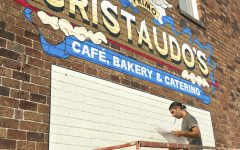 """Jared Davey, 40, from Carbondale, IL, is in charge of painting all of the logos of the businesses which occupy the building. Davey worked on the Cristaudo's logo on Wednesday, Sept. 9, 2020, in Carbondale, ILL. """"It is my interpretation of the logo,"""" Davey said when talking about the Cristaudo's logo which was originally created by Bob Hunter. Davey became a full-time artist in 2013, originally doing screen printing and sign painting for a few years. Another main sign painting job that Davey had was a mural at PK's Bar.See more of Davey's art at @jaydayvee."""