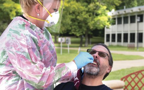 Amy Wright, nurse educator for the medical group at SIH, tests Ian Ruark, an administrative aid for the school of health sciences, for COVID-19 at SIU, Carbondale, ILL. Ruark said he is getting tested just to be on the safe side. SIH will be offering COVID-19 testing on campus on Mondays from 8:30 a.m. - 3 p.m. at the Becker Pavilion near the Campus Lake boat dock and Wednesdays from 10 a.m. - 4 p.m. at the southwest corner of Rinella Field across from the Student Health Center.