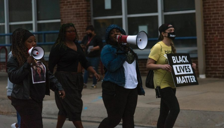 (From left to right) Nancy Maxwell, Emerald Avril, Elise Grabowska begins to lead the march in protest of the grand jury decision in the Breonna Taylor case on September 25, 2020 in Carbondale, ILL.