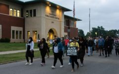 Chastity Mays, Nancy Maxwell, Emerald Avril and Elise Grabowska lead the march during a protest against the grand jury decision for the Breonna Taylor case on September 25, 2020, in Carbondale, ILL.