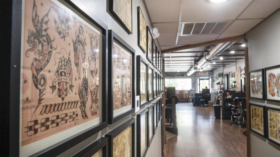 Several frames of tattoo artwork adorn the walls of Artistic Mind's new location on Tuesday Sept. 17, 2020, in Carbondale ILL. They are located at 520 South Illinois Avenue right here in Carbondale. Due to the COVID-19 pandemic, they are only taking customers by appointment and they're hours are from Tuesday - Saturday 12pm - 8pm.