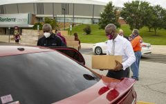 SIU Chancellor, Austin Lane, helps load produce  into peoples' cars during the Pandemic Relief Food Distribution event in front of the Banterra Center. Produce was donated by Cusumano's & Son's for people who have hit hard by the pandemic on Thursday, Sept. 3, 2020 at SIU.