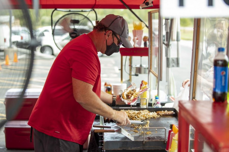 Jason York, of Elvis' Place Concessions, serves up some hot dogs off the grill during the Food Truck Fridays event at the Pavilion in Marion, IL. Food Truck Friday event was put on by the Pavilion and by the Marion Cultural and Civic Center. The event occurs each Friday, where people can come out and enjoy the different foods offered from different food trucks / vendors.