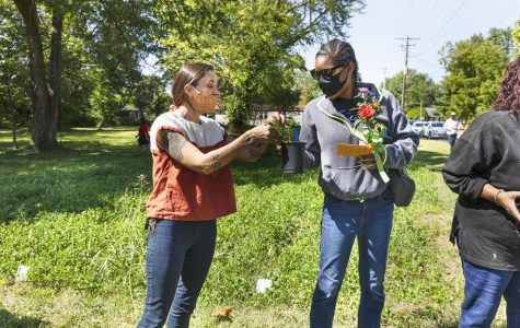 Volunteer, Jessica helps with the Women for Change free plant station at the Big Event on Saturday, Sept. 19, 2020 at the Red Hen community garden in Carbondale, IL. Jessica is a part of the Washington Street Garden and the Food Autonomy Project.