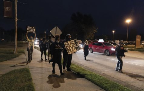 Protests erupt after grand jury does not charge Louisville officers in killing of Breonna Taylor