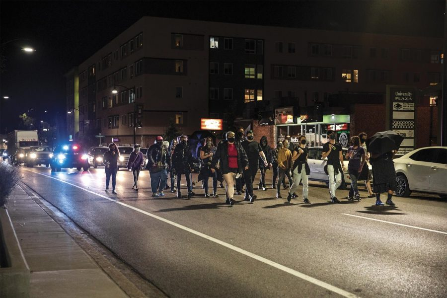 A police car follows the Breonna Taylor march down W. Main St. in Carbondale, Ill.