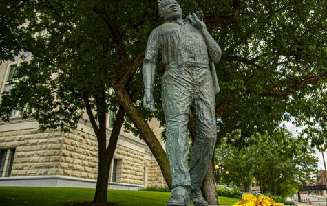 Sunflowers placed at the base of Dr. Martin Luther King Jr. statue on Sunday in downtown Springfield, IL, just two days after, the 57th anniversary of Martin Luther King Jr.'s March on Washington, where he delivered his famous
