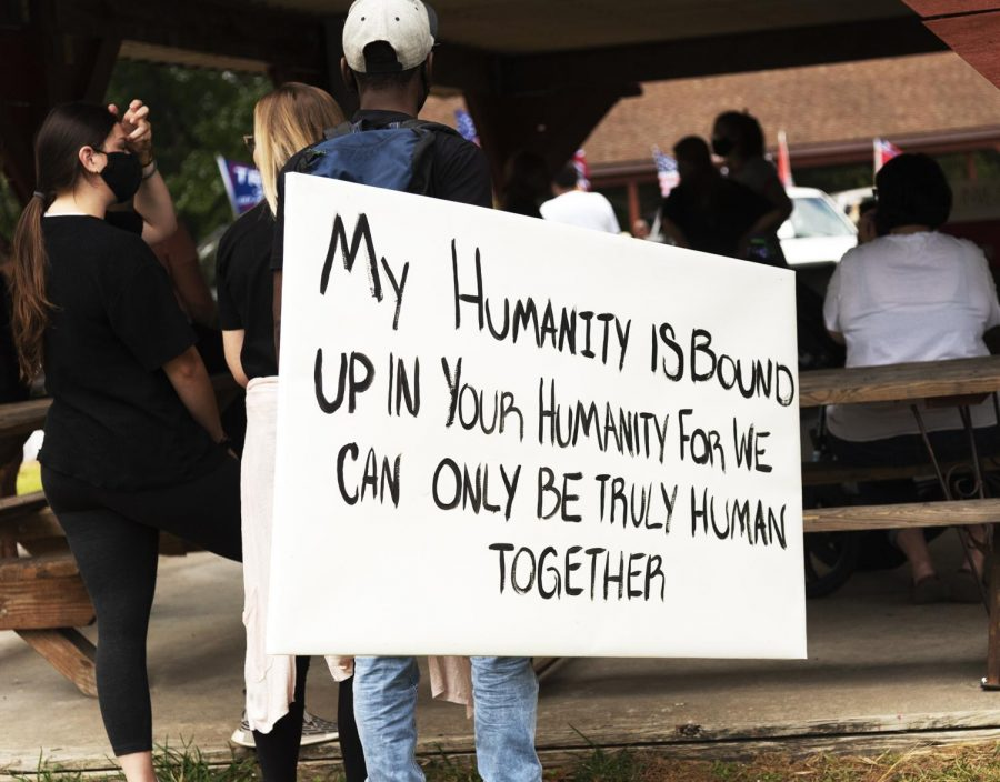 """Protestor Ezekiel Brown created a sign meant to bring people together because we're all human. Brown said he wanted his voice to be heard in this movement for change. """"I'm out here to uphold the values and ideas that the Constitution gave to us"""" Brown said on September, 27 2020 in Vienna ILL"""