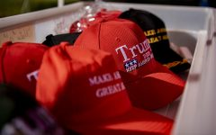 Trump hats sit in a bin at Doris Miller's Trump merchandise stand in Vienna, Ill. An avid Trump supporter, Miller sells Trump merchandise to raise profits for Trump.