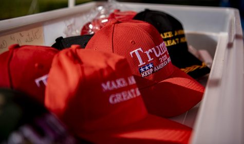 Trump hats sit in a bin at Doris Miller