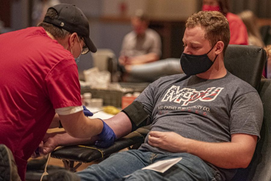 """Jonas Trimble, a SIU electrical engineering major, prepares to get blood drawn at a blood drive held by the American Red Cross at the Student Center Tuesday, Oct. 20, 2020.    """"Well, donations with blood like this saved my father's life, so it's kind of duty bound to do it myself to help save some other boy's father to stay alive,"""" Trimble said."""